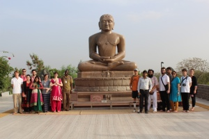 The attendees of the International School for Jain Studies with a statue of the 24th teacher of Jainism, Mahavira.