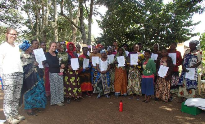 Women's group in Week 3 with their certificates.