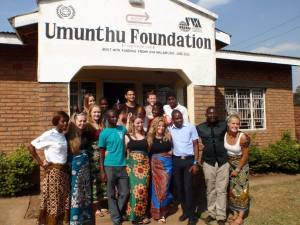 The group of volunteers posing with the Umunthu workers and the director, David Odali (bottom row, second from right)