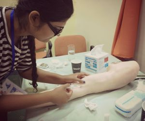 Practising phlebotomy on a dummy arm. Of course, gloves would be worn when doing this on a real patient!