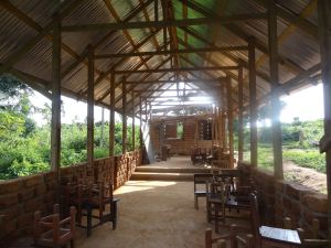 There were other brilliant building projects which had been completed throughout the village already. For example this school canteen, however, unfortunately the cement-earth ratio of the bricks used in the the construction of this structure are not withstanding the heavy rains, and are beginning too erode. This is why we spent so much time trying to find a good cement - earth ratio