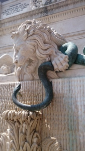 This statue in the centre of town commemorates the building of walls to protect Grenoble's people from flooding. The snake represents the water and the lion the city.