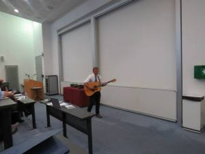 Associate Prof. Don Ferencz in his legendary lecture with a guitar