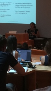 A lecturer from Brazil leading a lecture on the legal system in her country.
