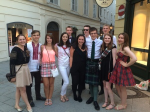 Scottish students posing with students from Ukraine, wearing their national dress